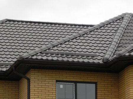 A house with a roof of grey Spanish tile...