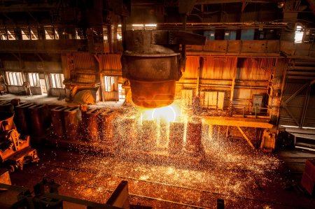 From ladle pours red-hot steel. Foundry....