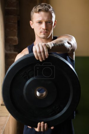 Man  with weight disc