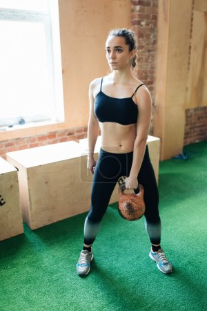 Woman holding kettle bell