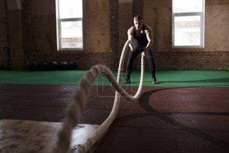 Athletic man doing cross-training