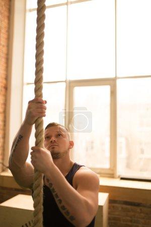 Man climbing rope