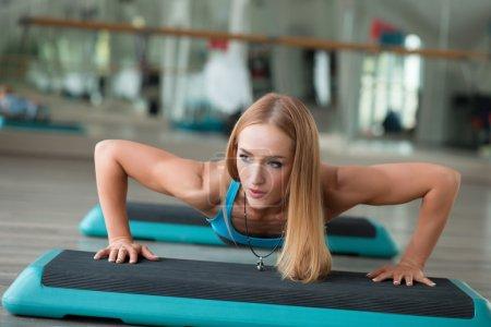 Strong woman doing push-ups