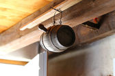 Wooden barrel hanging from ceiling in small Swiss cottage near Lavaux vineyards on Lake Geneva, Switzerland