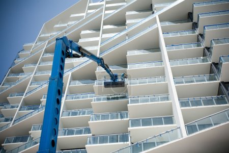 Photo for Construction crew on lift working on skyscraper - Royalty Free Image