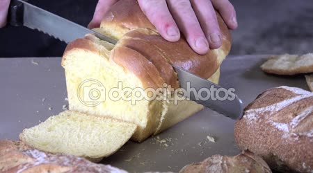 The baker cutting slices of brioche
