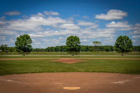 Baseball Field with Blue Sky and Clouds