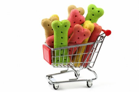 colored dog biscuits in a shopping trolley