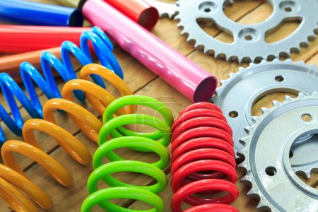 metal parts coated with powder coating on wooden background.