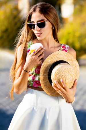 stylish hipster girl with straw hat