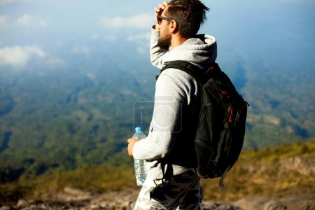 Man hiker looking at landmarks