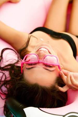 Sexy woman with pink sunglasses