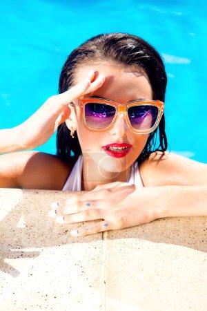 Sexy woman in bikini and sunglasses