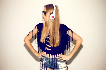 Blonde woman in headphones and sunglasses