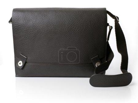 Black leather bag over white background