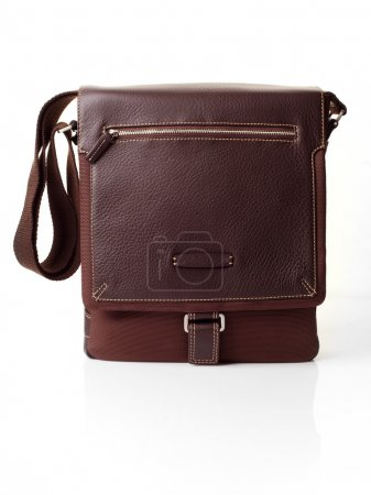 Brown leather bag over white background