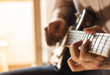 Photo for Practicing in playing guitar. - Royalty Free Image