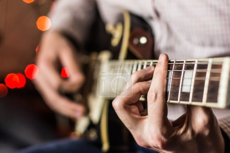 Photo for Practicing in playing guitar. Handsome young men playing guitar, - Royalty Free Image