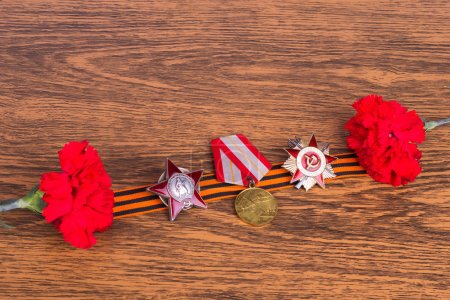 Two cloves, Grigoryevskaya ribbon and decorations on wooden back