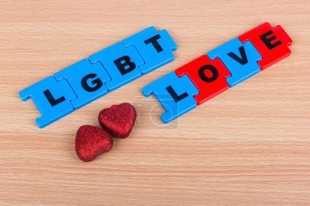 The inscription LGBT Love and two hearts on the table