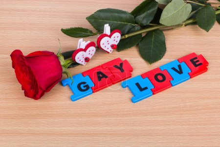 "The words ""Gay love"", a rose and two hearts"