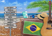 Concept of summer traveling with old suitcase and Brazil town sign