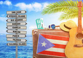 Concept of summer traveling with old suitcase and Puerto Rico town sign with burning sun