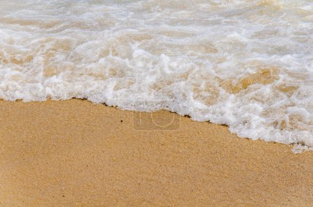 Photo for Foam wave on sea close with beach background - Royalty Free Image