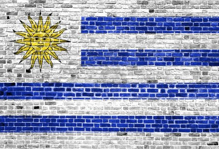 Photo pour Drapeau de l'Uruguay peint sur un mur de briques - image libre de droit