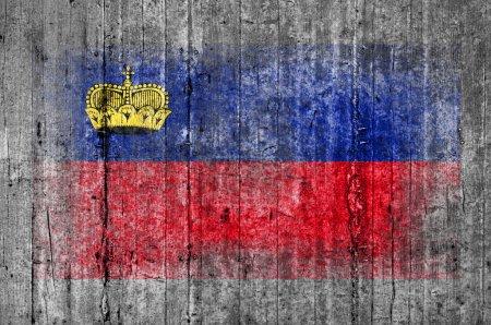 Liechtenstein flag painted on background texture gray concrete