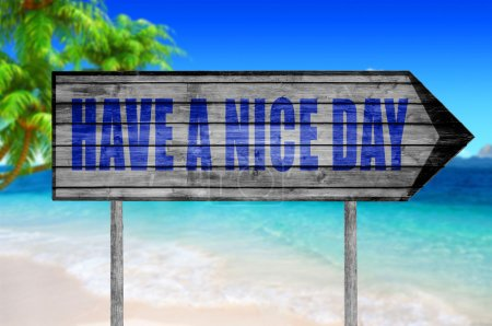 Have a Nice Day wooden sign with on a beach background