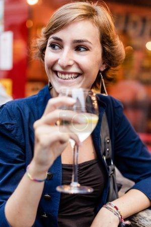 Woman drinking an aperitif