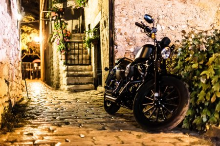 Motorbike parked  in the alley
