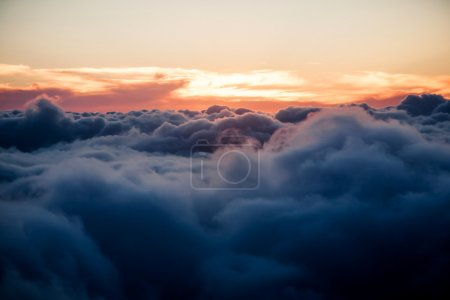 Photo for Sunrise above  the clouds,view from the plane - Royalty Free Image