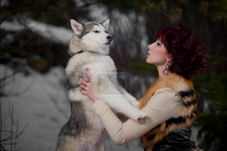 Beautiful woman with a husky dogs