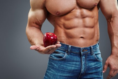 Strong Man holding a Red Apple