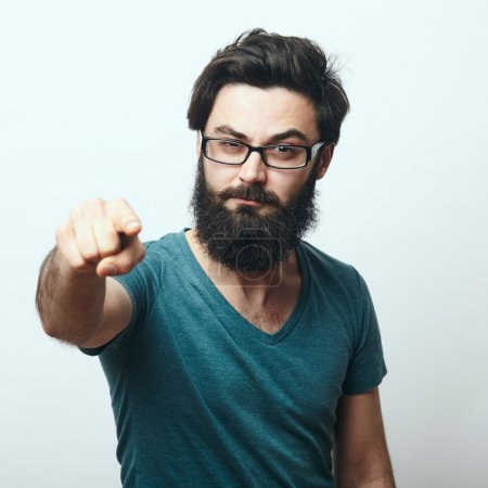 Photo for Portrait of young bearded man with glasses pointing his finger to the camera. We need you concept. Programmer, IT specialist pointing to camera. - Royalty Free Image