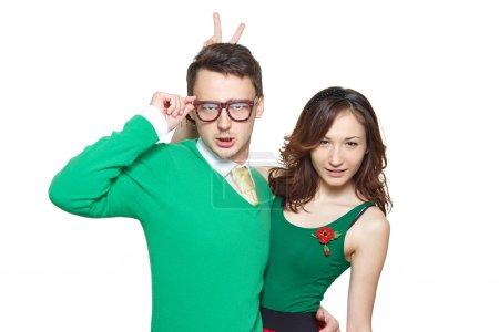 Happy nerd couple isolated on white