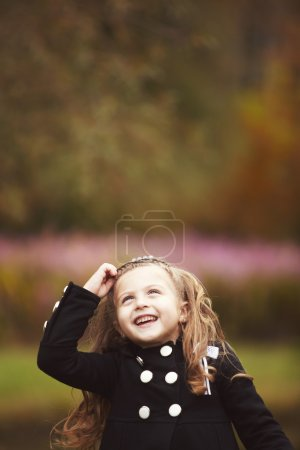 Cute little girl thinking with copy space