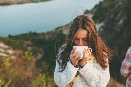 Teenage girl drinking coffee.