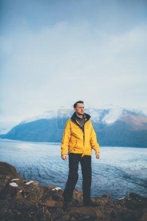 Man standing on mountain achievement.