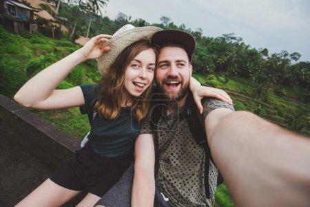 Young couple taking selfie on Bali