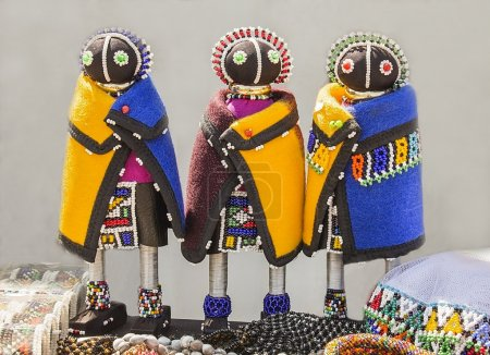African handmade rag dolls. Colorful beads, fabrics clothes. Local craft market in South Africa. Ethnic costume of tribe Sesotho, Basotho