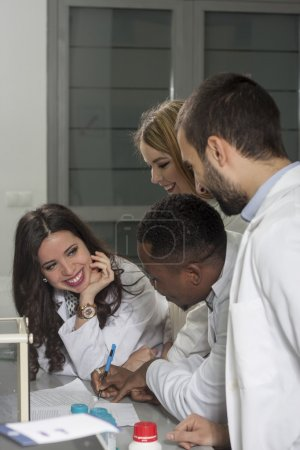 Group of young medical workers are working in lab as lab technic