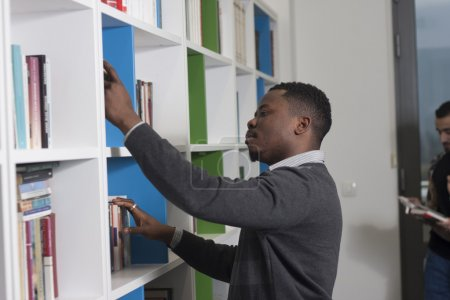 Students searching for books in the library