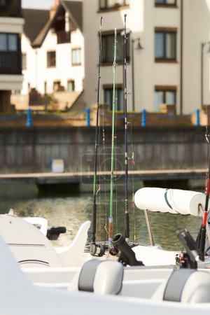 Photo for Fishing rods with reels on the boat in natural setting - Royalty Free Image