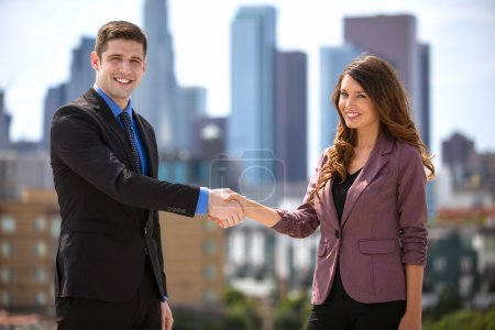 Business colleagues meeting and greeting shaking hands partnership success