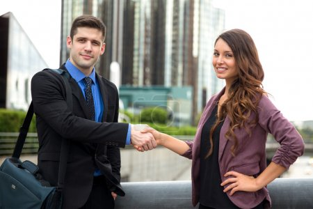 Partners clients deal handshake handsome man woman business finance relationship