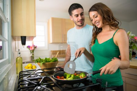 Photo for Man and woman chef cook frying pan vegetables vegan vegetarian fajitas sunny day love married dating cooking - Royalty Free Image