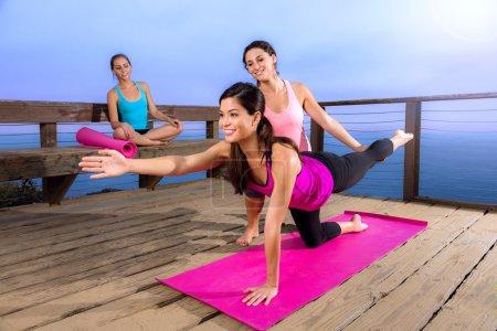 Beautiful model female woman yoga pose personal trainer class instructor friends retreat
